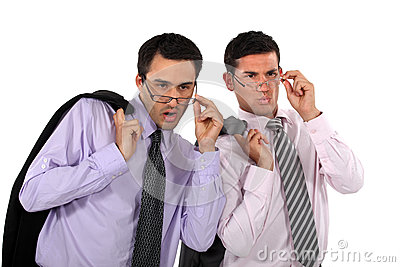 Businessmen looking over their glasses