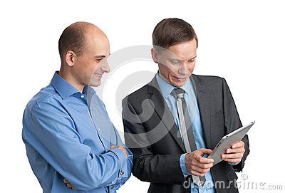 Businessmen meeting and looking at tablet computer
