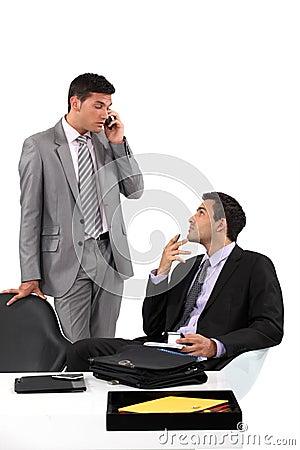 Businessmen patiently waiting