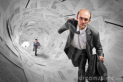 Businessmen running inside documents tunnel