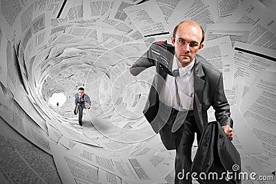 Businessmen running inside documents tunnel