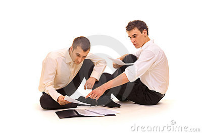Businessmen scrutinizing contracts
