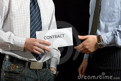 Businessmen sharing a contract