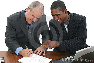 Businessmen Signing Contracts
