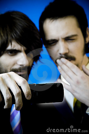 Businessmen studying cellphone
