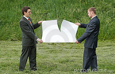 Businessmen tearing sheet of paper