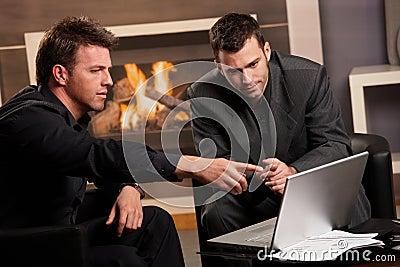 Businessmen using laptop computer