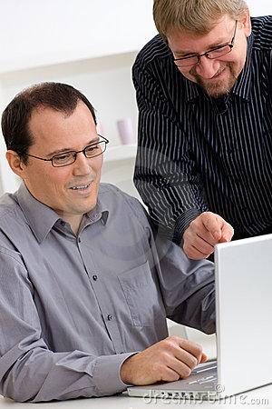 Businessmen using laptop computer
