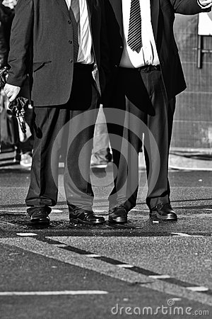 Businessmen waiting at the pedestrian crossing