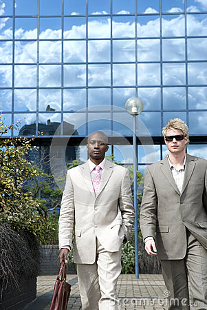 Businessmen Walking Blue Background