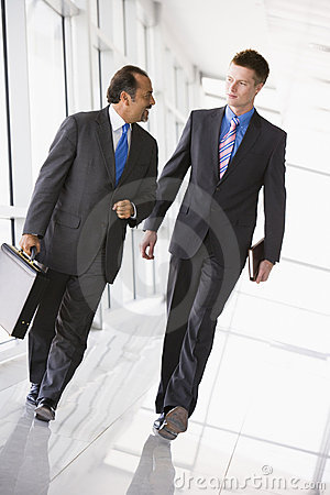 Businessmen walking through lobby