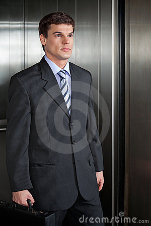 Businessmen Walking Out From Elevator