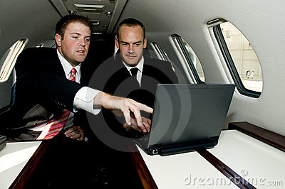 Businessmen working on a corporate jet