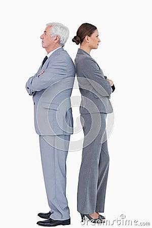 Businesspartner standing back to back