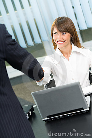 Businesspeople cheering by handshake