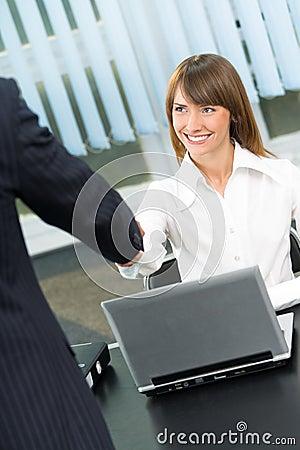Businesspeople cheering by handshake