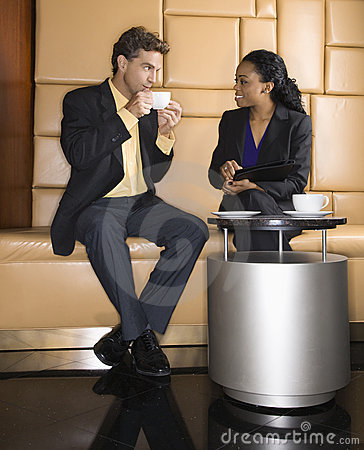 Businesspeople drinking coffee.