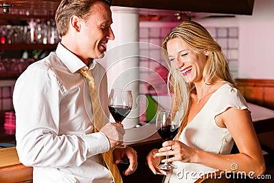 Businesspeople flirting in hotel bar