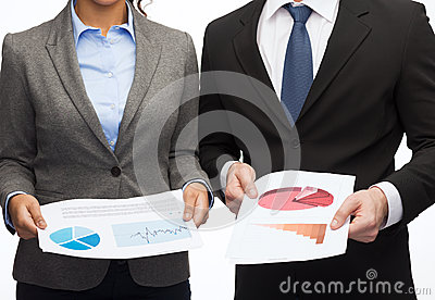 Businesspeople with graphs and charts