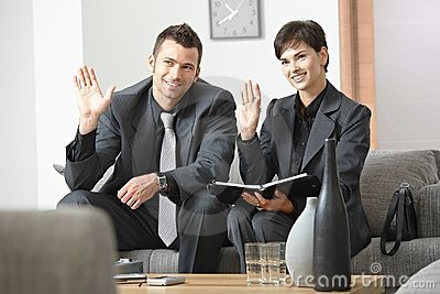 Businesspeople greeting partner