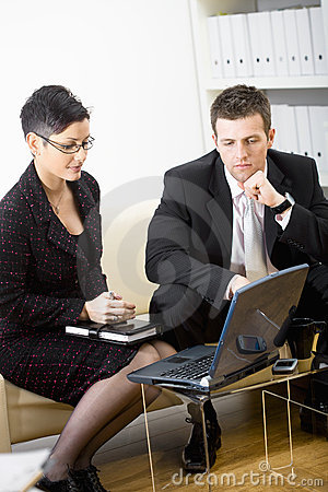 Businesspeople with laptop