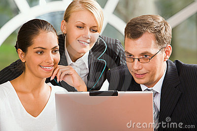 Businesspeople with the laptop