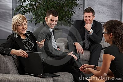 Businesspeople listening to businesswoman