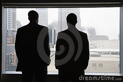 Businesspeople Looking Out of a Window