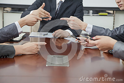 Businesspeople Making Gestures During Business Meeting