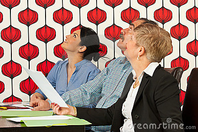 Businesspeople at meeting looking up