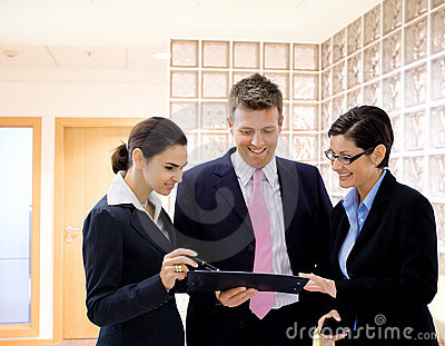 Businesspeople reviewing documents