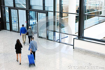 Businesspeople Rushing through Corridor, Motion Blur
