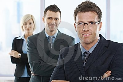 Businesspeople smiling at camera