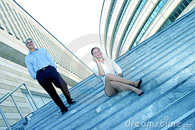 Businesspeople On Steps Of Office Complex