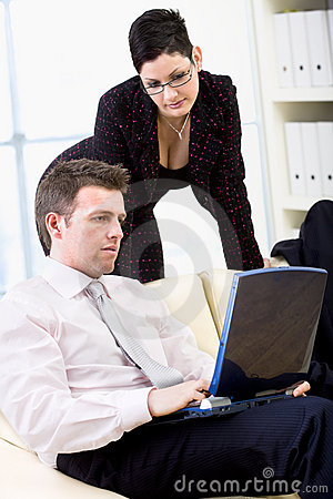 Businesspeople teamworking on laptop