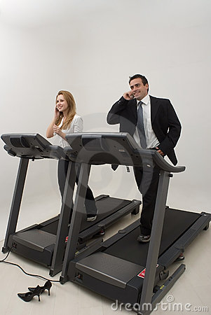 Businesspeople on a Treadmill - Vertical