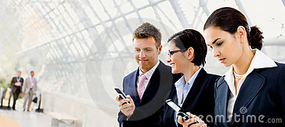 Businesspeople using mobile phone