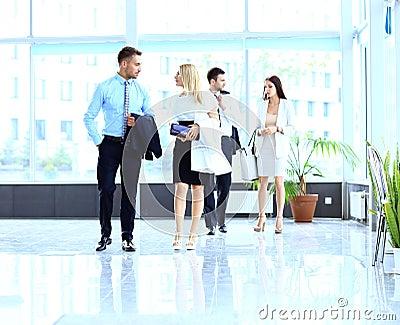 Businesspeople walking in the corrido
