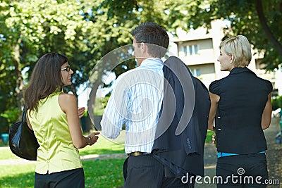 Businesspeople walking in park