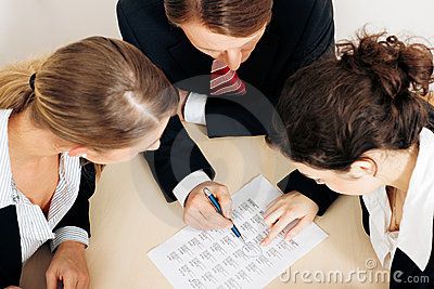 Businesspeople working on spreadsheet