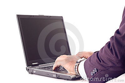 Businessperson working on a laptop computer