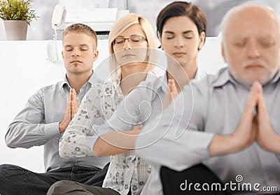 Businessteam doing yoga exercise