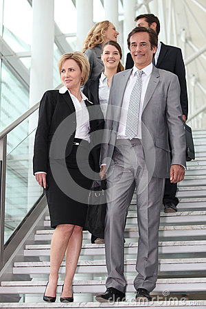 Businessteam walking down steps