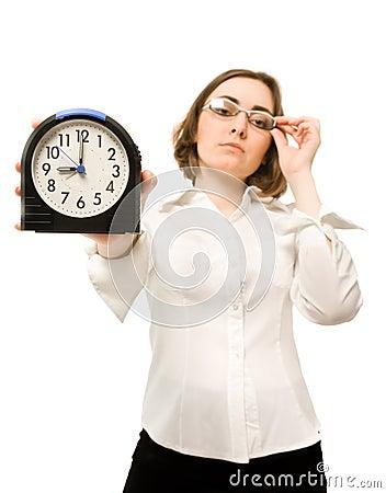 Businesswoman with alarm clock (focus on clock)