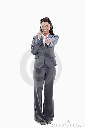 Businesswoman approving with a headset