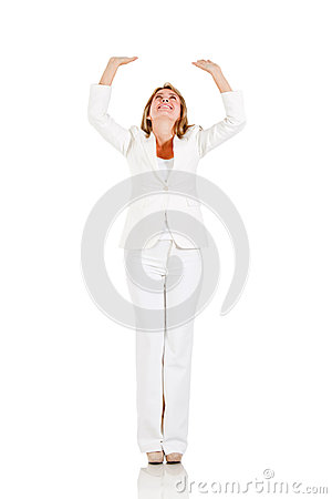 Businesswoman with arms up