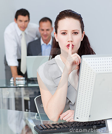 Businesswoman asking for silence in the office