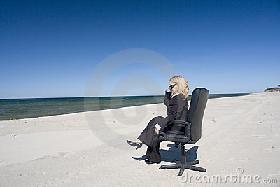 Businesswoman on beach