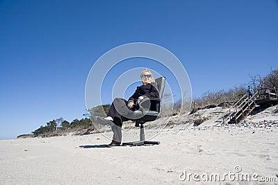Businesswoman on beach