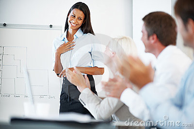 Businesswoman being appreciated by her colleagues